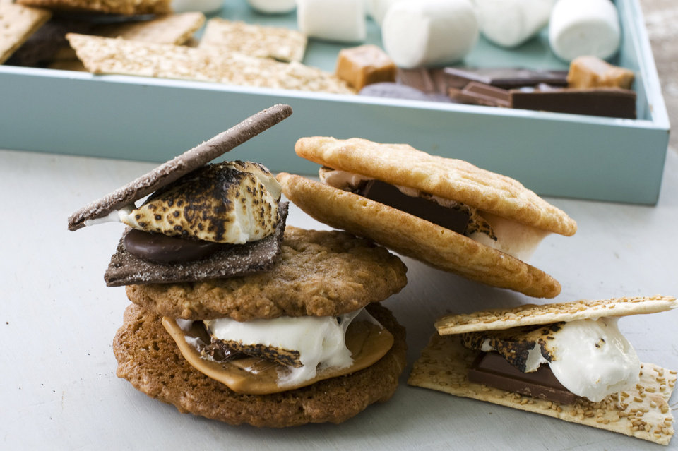 Photo - Clockwise from top left: A double chocolate grasshopper s'more, a toasted mocha s'more, a sesame caramel s'more and a salted oatmeal s'more. AP Photo  Matthew Mead - AP