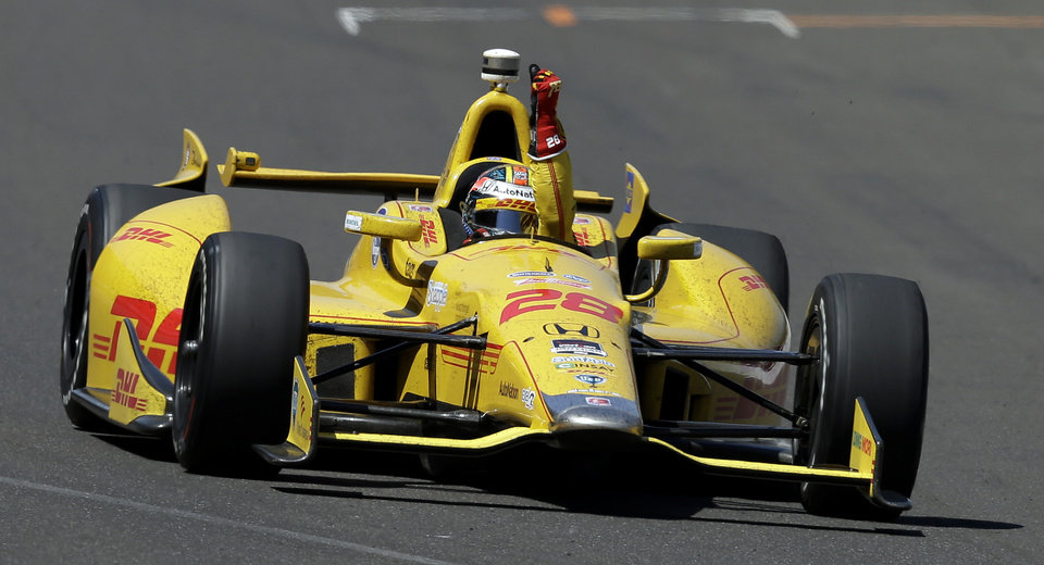Photo - Ryan Hunter-Reay celebrates after winning the Indianapolis 500 IndyCar auto race at the Indianapolis Motor Speedway in Indianapolis, Sunday, May 25, 2014. (AP Photo/Darron Cummings)
