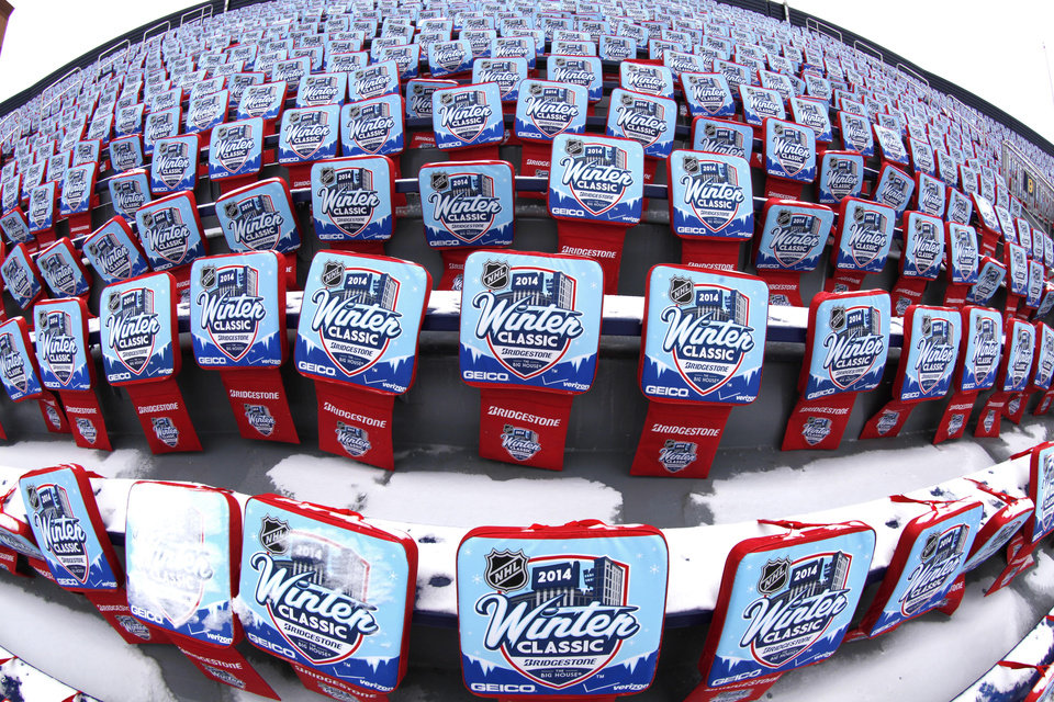 In this image taken with a fisheye lens, NHL Winter Classic hockey game seat pads are displayed at Michigan Stadium in preparation for the outdoor hockey game between the Detroit Red Wings and Tornto Maple Leafs Tuesday, Dec. 31, 2013, in Ann Arbor, Mich. The game is scheduled for New Year's Day.  (AP Photo/Paul Sancya)
