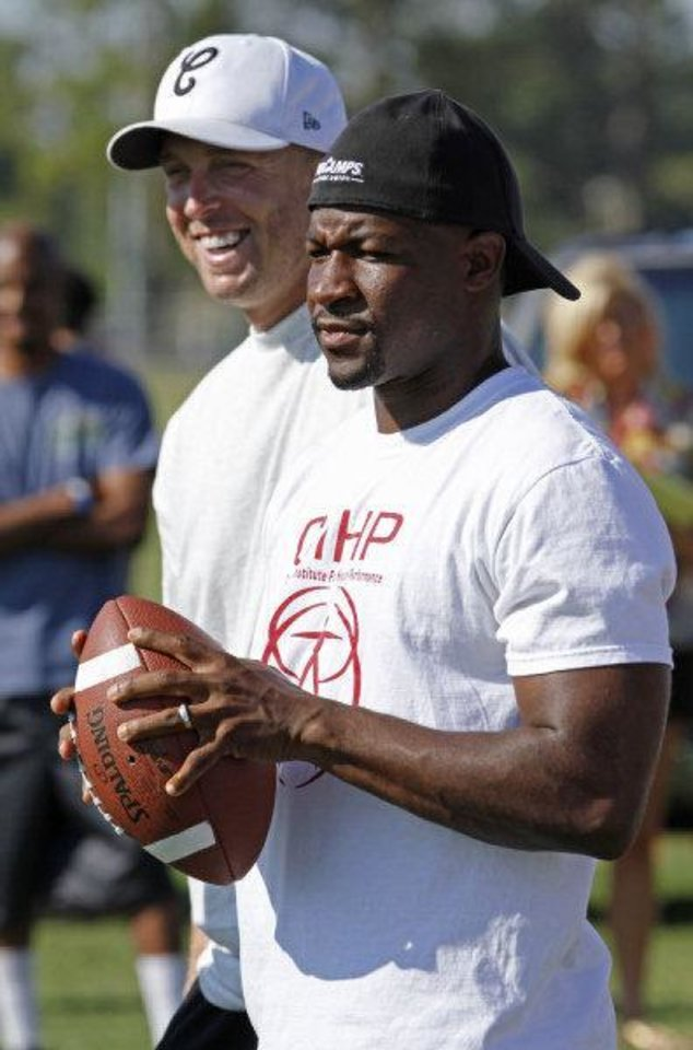 jason White (left) and Mark Clayton prepare to impart their knowledge at Adrian Peterson Football Camp on Thursday, June 23, 2011, in Norman, Okla. Photo by Steve Sisney, The Oklahoman <strong>STEVE SISNEY</strong>