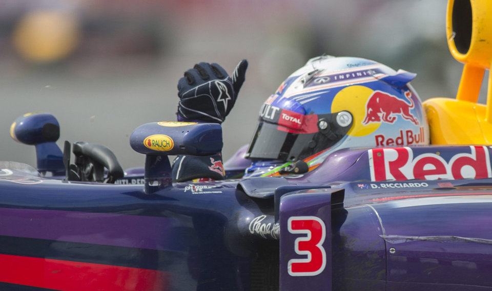 Photo - Red Bull driver Daniel Ricciardo from Australia waves to fans after winning the Canadian Grand Prix, Sunday, June 8, 2014 in Montreal. (AP Photo/The Canadian Press, Graham Hughes)