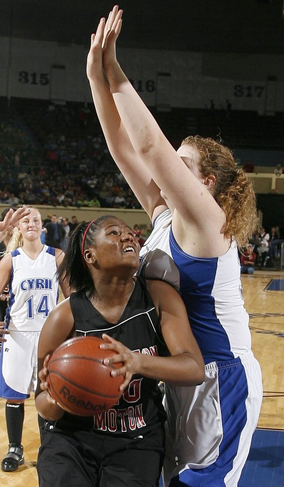 Photo - Boynton-Moton's Shawonda Long looks to shoot as Cyril's Shelbi Skaggs defends during the finals of the Class B girls basketball state tournament  between Cyril and Boynton-Moton at the State Fair Arena, Saturday, March 6, 2010, in Oklahoma City. Photo by Sarah Phipps, The Oklahoman