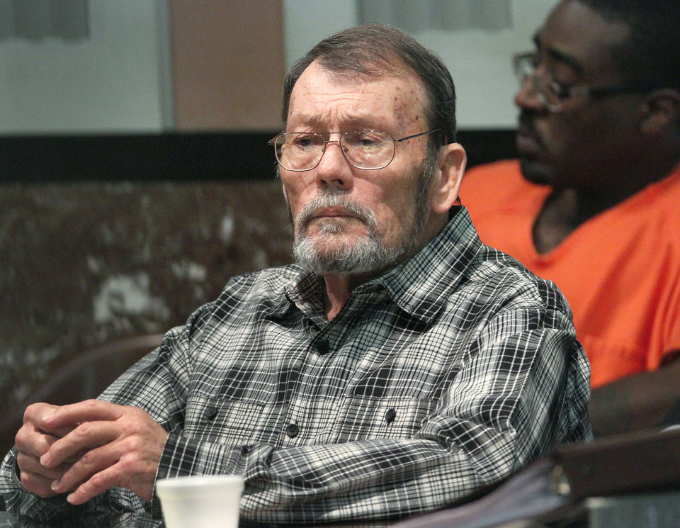 Photo - Defendant David Edinburgh sits in Judge Ray Elliott's courtroom at the Oklahoma County Courthouse, Monday, April 9, 2012.  .   Photo by Jim Beckel, The Oklahoman