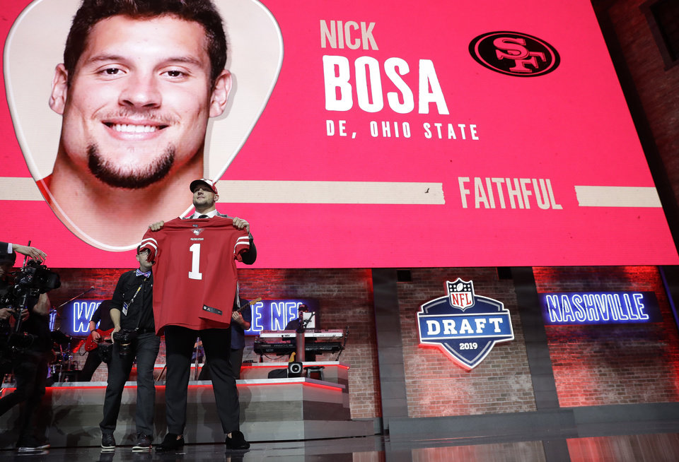 Photo - Ohio State defensive end Nick Bosa shows off his new jersey after the San Francisco 49ers selected Bosa in the first round at the NFL football draft, Thursday, April 25, 2019, in Nashville, Tenn. (AP Photo/Mark Humphrey)