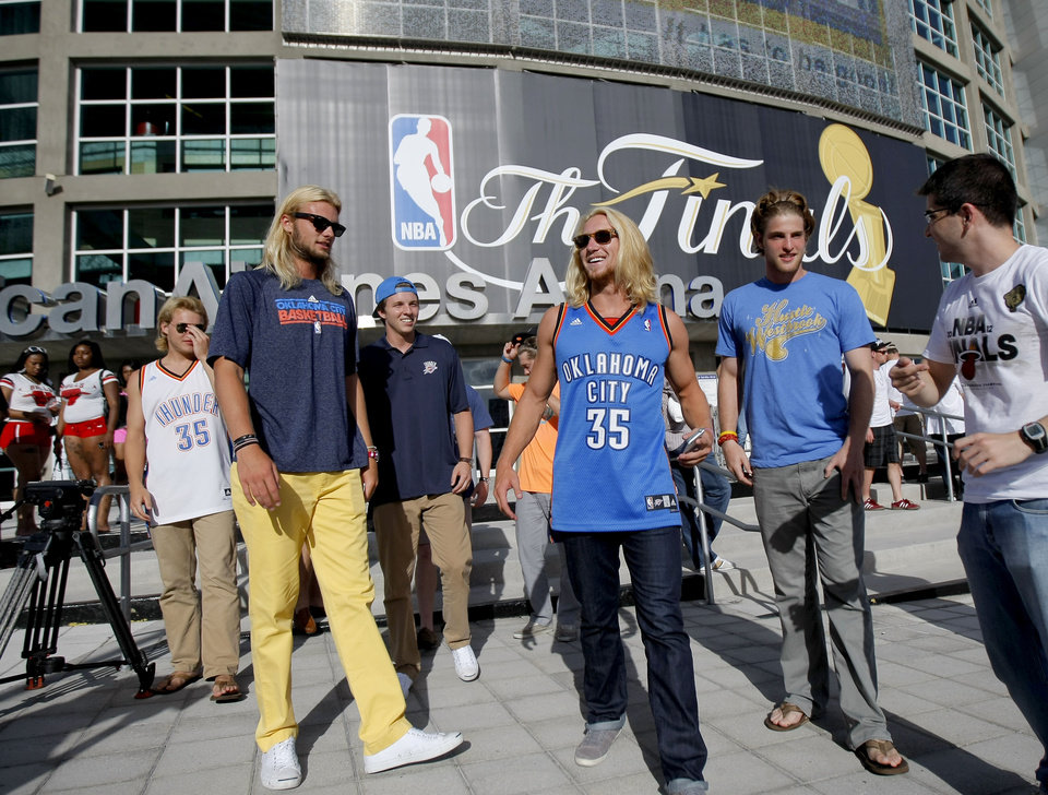 Photo - Oklahoma CIty fans Kassidy Cook, center, Taylor Langley, and Ben Donnelli, right, from Oklahoma City walk outside the arena before Game 3 of the NBA Finals between the Oklahoma City Thunder and the Miami Heat at American Airlines Arena, Sunday, June 17, 2012. Photo by Bryan Terry, The Oklahoman