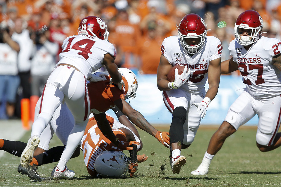 Photo - Oklahoma's Kennedy Brooks (26) carries the ball during the Red River Showdown college football game between the University of Oklahoma Sooners (OU) and the Texas Longhorns (UT) at Cotton Bowl Stadium in Dallas, Saturday, Oct. 12, 2019. Oklahoma won 34-27. [Bryan Terry/The Oklahoman]