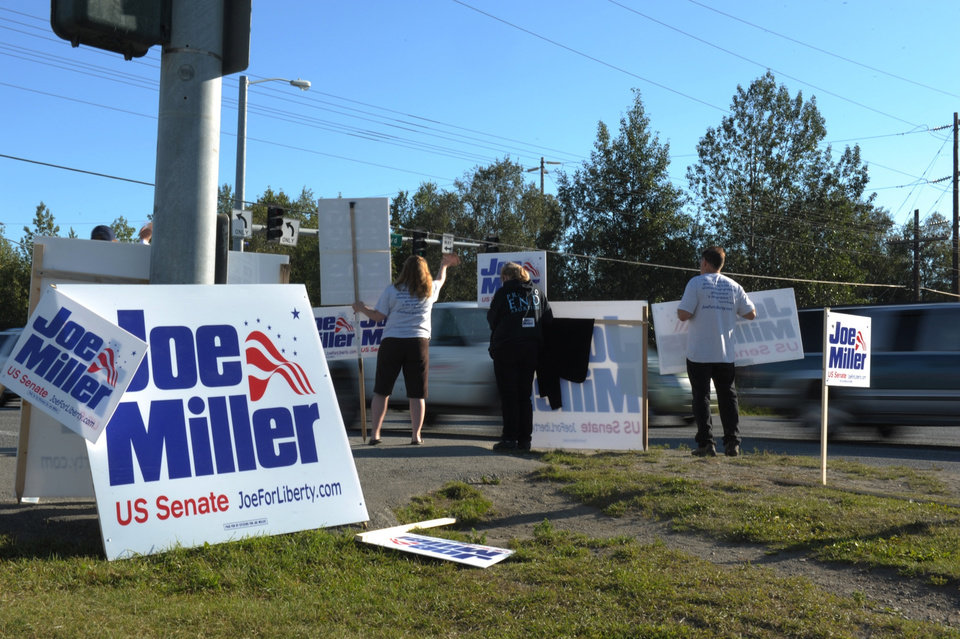 Photo - Joe Miller supporters campaign at the intersection of New Seward Highway and Northern Lights Blvd. in Anchorage, Alaksa Tuesday, Aug. 19, 2014, during the state's primary election. Miller is running his second campaign for United States Senate.    (AP Photo/Michael Dinneen)