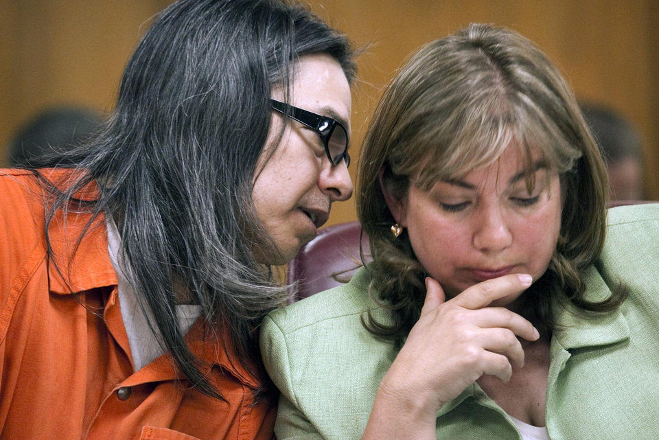 Photo -   Daniel U. Perez talks with his attorney Alice Osburn during his preliminary hearing in Sedgwick County District Court in Wichita, Kan., Thursday June 7, 2012. Perez, 52, the self-proclaimed leader of a Kansas commune that lived off life insurance payouts of its dead members has been ordered to stand trial on a charge of premeditated first-degree murder. (AP Photo/The Wichita Eagle, Mike Hutmacher)