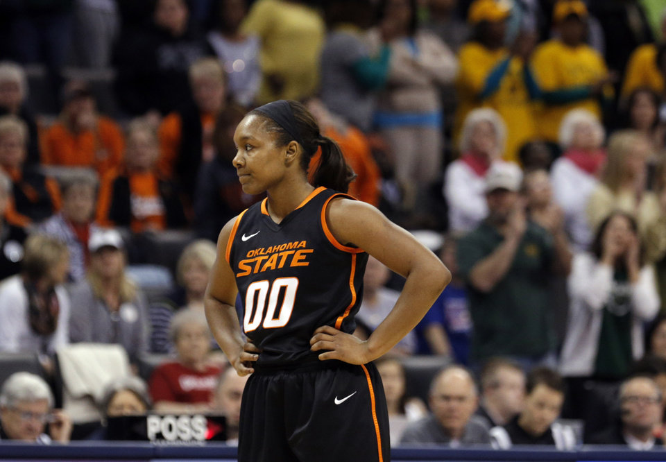 Photo - Oklahoma State's Roshunda Johnson (00) reacts in the final minute of the Women's Big 12 basketball tournament game between Baylor and Oklahoma State at Chesapeake Energy Arena  in Oklahoma City, Okla., Sunday, March 9, 2014. Photo by Sarah Phipps, The Oklahoman