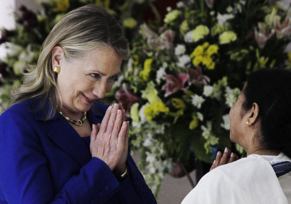 Photo -   U.S. Secretary of State Hillary Rodham Clinton, left, and West Bengal Chief Minister Mamata Banerjee greet each other before a meeting in Kolkata, India, Monday, May 7, 2012. Clinton met with Banerjee, a key partner of India's ruling coalition who has stymied government efforts to lift restrictions on foreign-owned investments in the country. (AP Photo/Bikas Das)