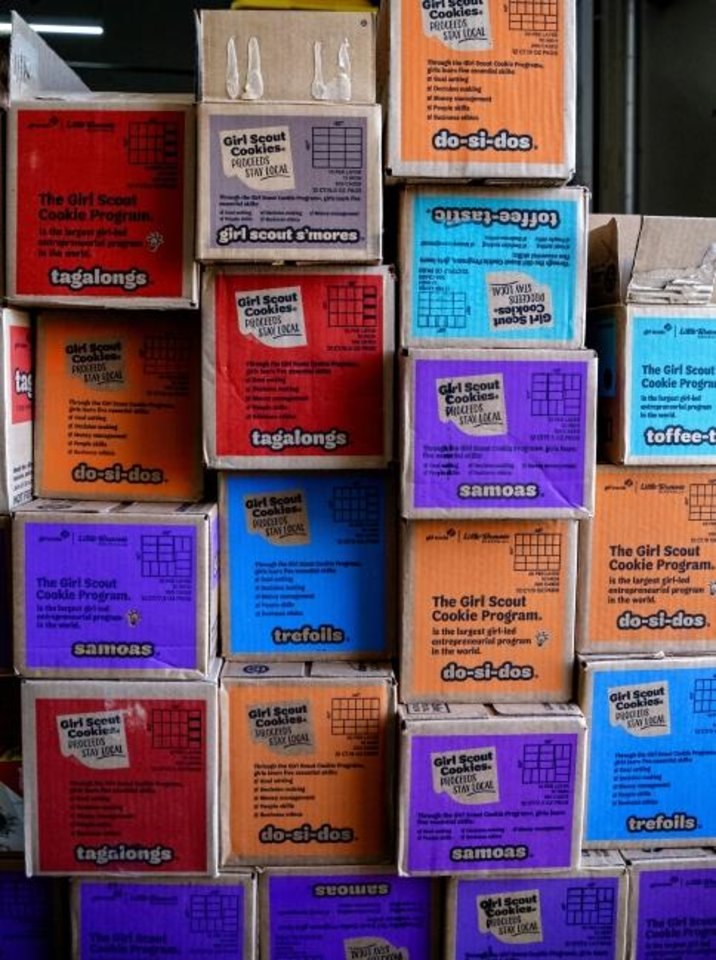 Photo -  Some of the 18,000 boxes of Girl Scout cookies that are being distributed to nonprofit agencies in central Oklahoma, Canadian and Logan counties to be used in feeding programs for individuals experiencing homelessness, child care programs and resource centers for children and families in need. [Chris Landsberger/The Oklahoman]