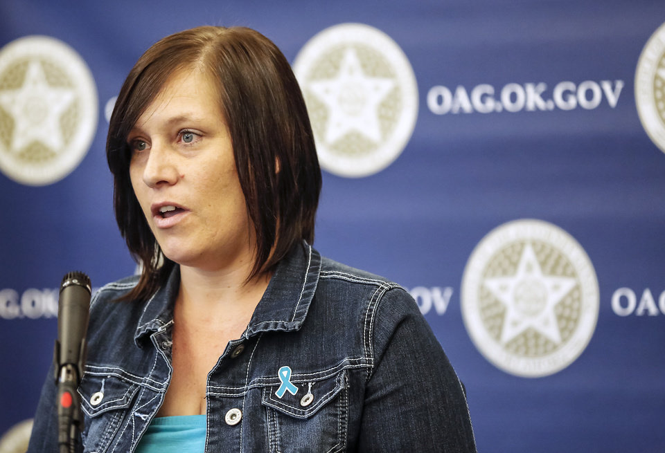 Sexual assault survivor Tonia Byers  speaks during a ceremony to promote Sexual Assault Awareness Month at the Attorney General's office on Monday, April 8, 2013, in Oklahoma City, Okla.