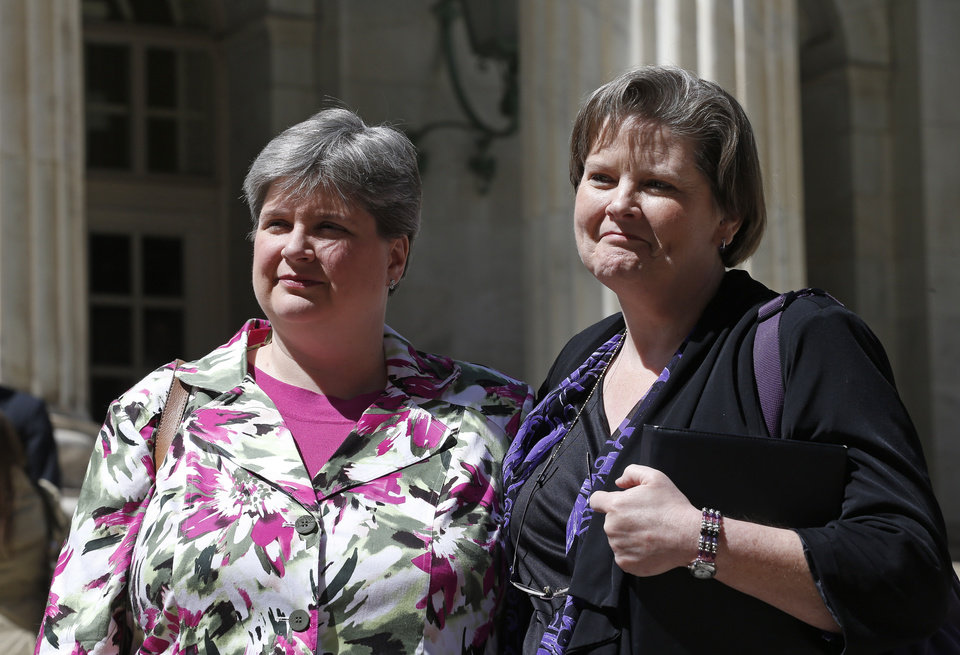 Photo - File - In the April 17, 2014, photo plaintiffs challenging Oklahoma's gay marriage ban Sharon Baldwin, left, and her partner Mary Bishop leave court following a hearing at the 10th U.S. Circuit Court of Appeals in Denver, Thursday, April 17, 2014. (AP Photo/Brennan Linsley, File)