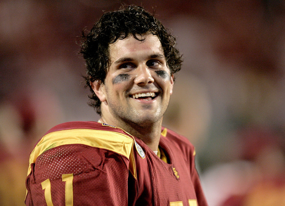 Photo - Miami, Florida - January 4, 2005. University of Oklahoma (OU) Sooners vs. University of Southern California (USC) Trojans college football in the Orange Bowl BCS National Championship at Pro Player Stadium. USC quarterback Matt Leinart smiles on the sideline after an USC touchdown against Oklahoma.  By Nate Billings/The Oklahoman