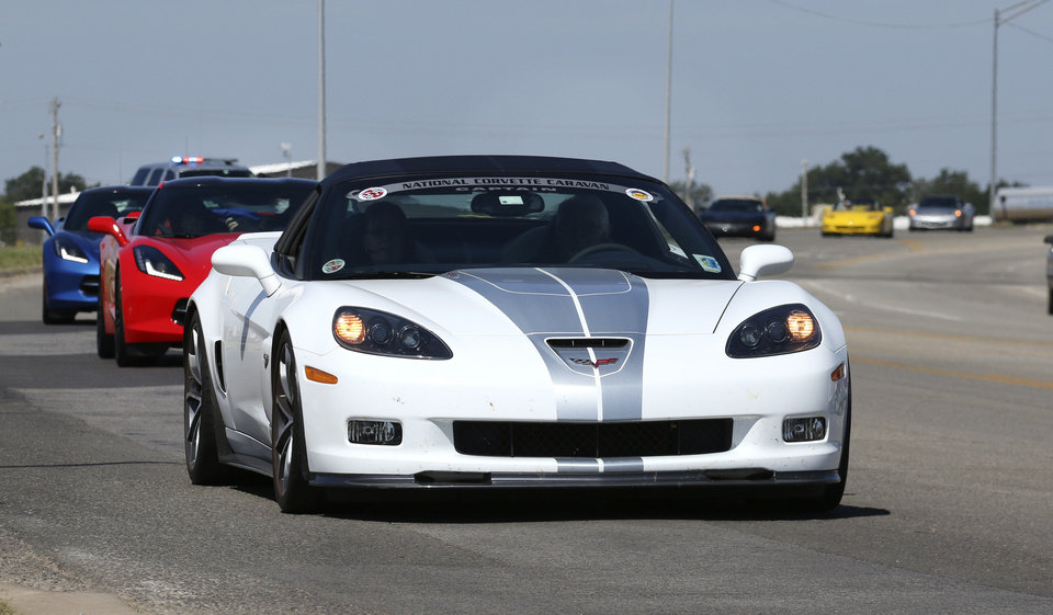 Photo - Chevrolet Corvettes arrive at Frontier Chevrolet in El Reno, Monday August  25, 2014. Corvette enthusiast made a stop in El Reno on their cross country trip in National Corvette Caravan.  Photo By Steve Gooch, The Oklahoman