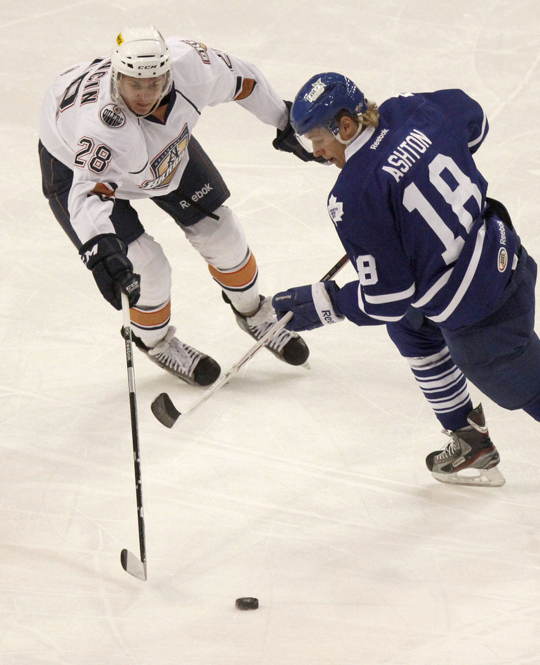 OKLAHOMA CITY BARONS / AHL HOCKEY: The Barons' Martin Marincin and Toronto Marlies' Carter Ashton try to gain control of the puck during Field Trip Day with the Barons Hockey at the Cox Convention Center in Oklahoma City, OK, Tuesday, November 13, 2012,  By Paul Hellstern, The Oklahoman