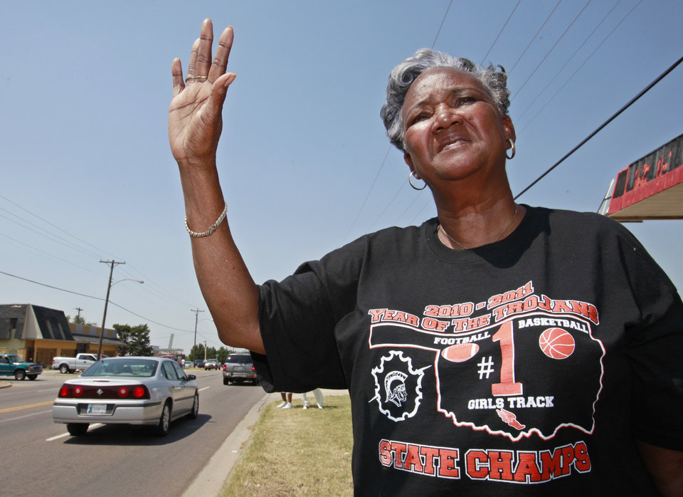 Photo - DEATH: Rose Davis, who had marched with Clara Luper in 1961, waves to the funeral procession as it moves along Martin Luther King Avenue, Friday,  June 17, 2011.      Photo by David McDaniel, The Oklahoman  ORG XMIT: KOD