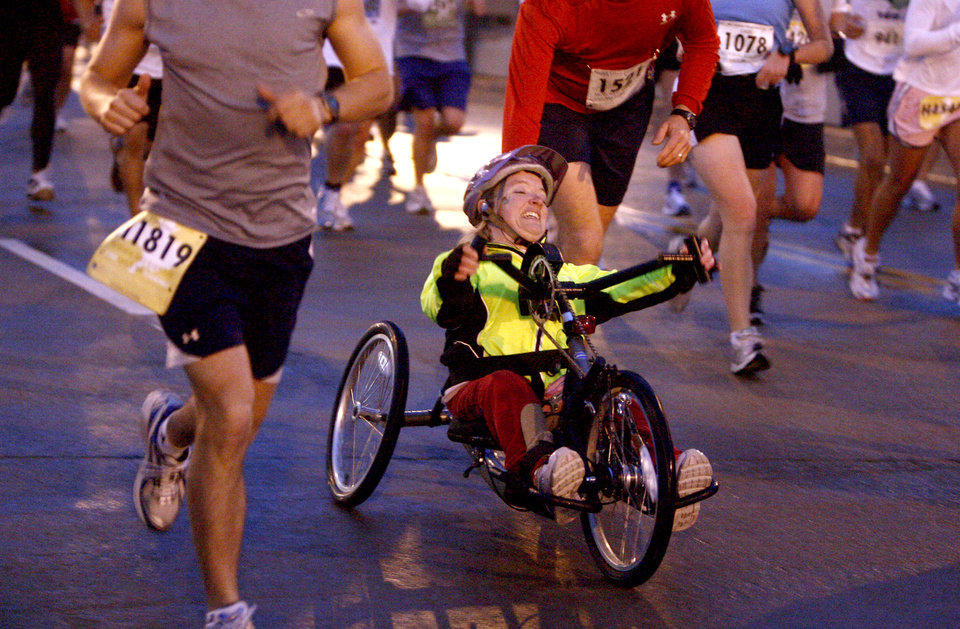 A wheelchair participate gets help from other runners on the Walnut Street bridge during the 8th annual Oklahoma City Memorial Marathon on Sunday, April 27, 2008, in Oklahoma City, Okla.