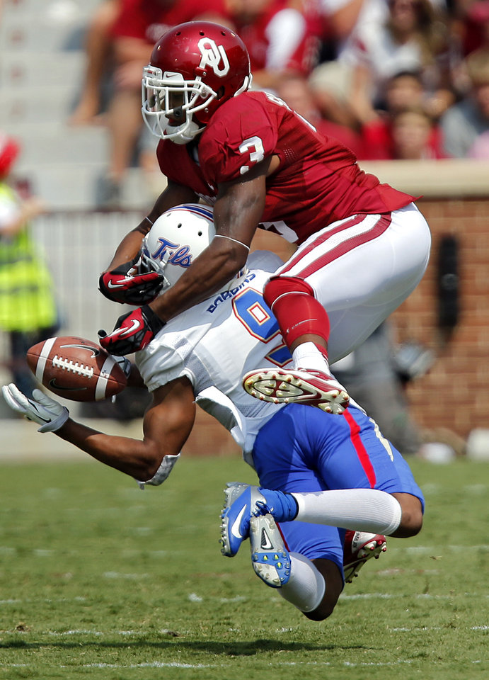 Photo - Tulsa 's Dwight Dobbins (9) breaks up a pass for Oklahoma's Sterling Shepard (3) during the college football game between the University of Oklahoma Sooners (OU) and the University of Tulsa Hurricanes (TU) at the Gaylord-Family Oklahoma Memorial Stadium on Saturday, Sept. 14, 2013 in Norman, Okla.  Photo by Chris Landsberger, The Oklahoman