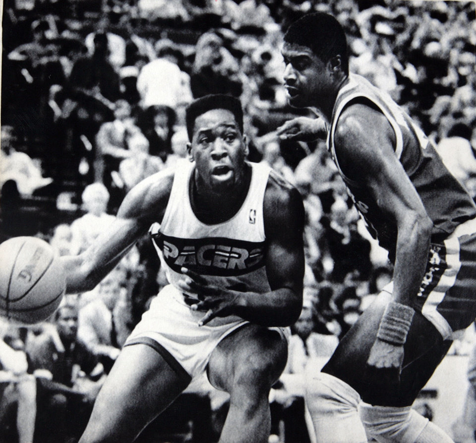 Former OU basketball player Wayman Tisdale. Former Sooner Wayman Tisdale (left) drives past Golden State's Jerome Whitehead in Monday's NBA game in Indianapolis. Wayman and the Pacers won, 112-93. Story, Page 28. 2-18-87, 10-19-88 ORG XMIT: KOD