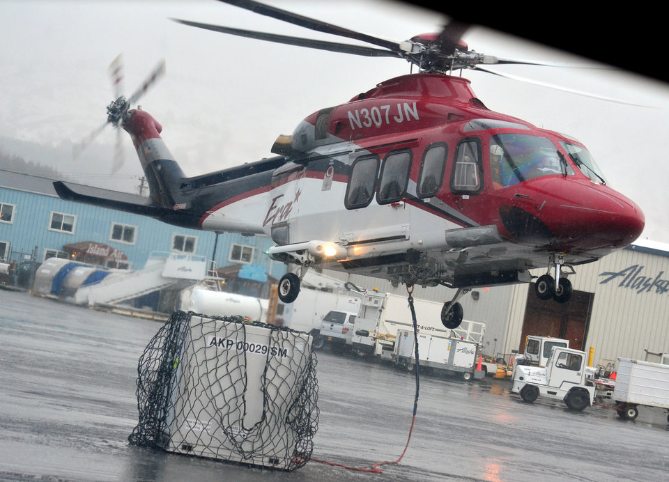 Photo - An Era Alaska helicopter lifts off from Kodiak State Airport, in Kodiak, Alaska, on Monday afternoon, Jan. 7, 2012 en route to the floating drill ship Kulluk on Monday afternoon, Jan. 7, 2013. Salvage teams conducted an in-depth assessment of its seaworthiness. The Kulluk, which ran aground a week ago on Sitkalidak Island near Kodiak, was taken to Kiliuda Bay for repairs and a survey. (AP Photo/Kodiak Daily Mirror, James Brooks)