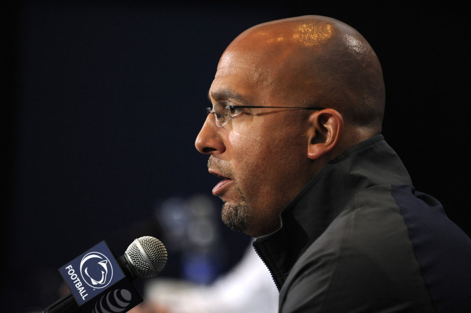 Photo - Penn State NCAA college football head coach James Franklin speaks during his weekly press conference, in State College, Pa., Tuesday, Aug. 26, 2014.  Penn State plays Central Florida at Croke Park Stadium in Dublin, Ireland, on Saturday. (AP Photo/Centre Daily Times, Nabil K.Mark ) MANDATORY CREDIT; MAGS OUT