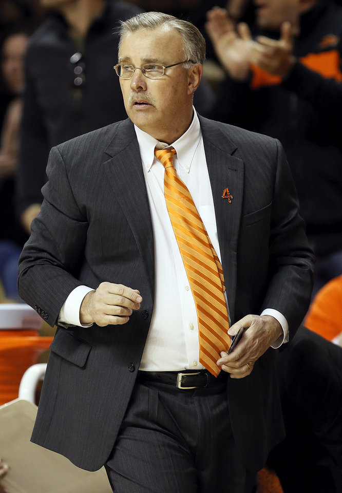 Photo - OSU head coach Jim Littell watches from the bench area during a women's college basketball game between Oklahoma State University (OSU) and the University of Texas at Gallagher-Iba Arena in Stillwater, Okla., Saturday, March 2, 2013. OSU won, 64-58. Photo by Nate Billings, The Oklahoman