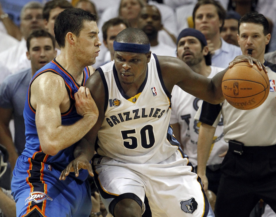 Photo - Memphis Grizzlies forward Zach Randolph (50) tries to get past Oklahoma City Thunder forward Nick Collison, left, in overtime during Game 3 of a second-round NBA basketball series, Saturday, May 7, 2011, in Memphis, Tenn. Randolph led the Grizzlies with 21 points as the Grizzlies won 101-93 in overtime to take a 2-1 lead in the series. (AP Photo/Mark Humphrey)