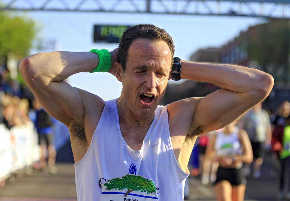 Photo - Daivd Luke reacts as he finishes the half marathon during the Oklahoma City Marathon in Oklahoma City, Okla. on Sunday, April 29, 2018.  . Photo by Chris Landsberger, The Oklahoman