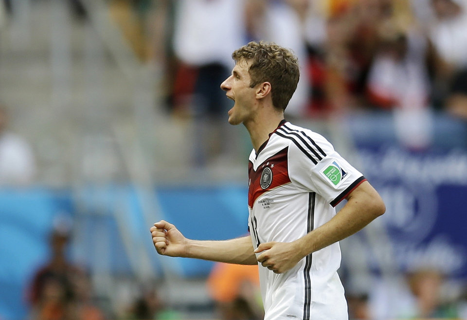 Photo - Germany's Thomas Mueller runs off the pitch during the second half after scoring his side's fourth goal during the group G World Cup soccer match between Germany and Portugal at the Arena Fonte Nova in Salvador, Brazil, Monday, June 16, 2014.  (AP Photo/Natacha Pisarenko)