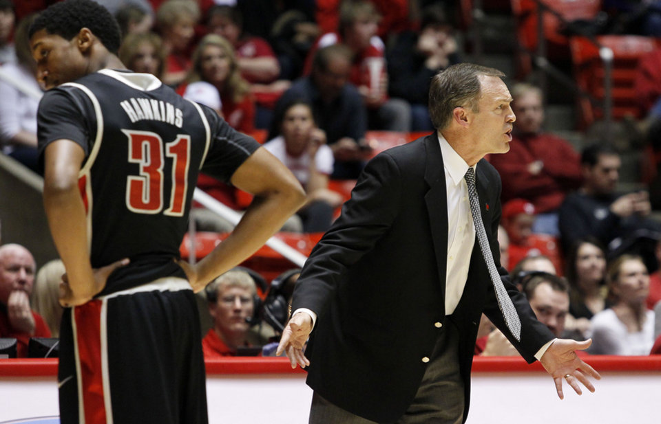 Photo - UNLV head coach, Lon Kruger, right, reacts to a foul charged to his Rebels guard Justin Hawkins, left, during the second half of an NCAA college basketball game against Utah in Salt Lake City, Utah, Saturday, March 5, 2011. UNLV defeated Utah 78-58. (AP Photo/Colin E Braley)