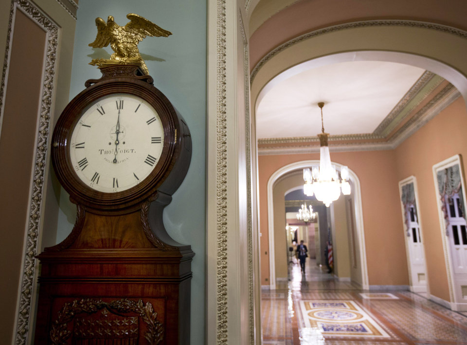 "FILE - In this Tuesday, Jan. 1, 2013, file photo, the Ohio Clock strikes midnight as the Senate continues to work on the fiscal cliff, on Capitol Hill in Washington. The deal in Congress that stopped the country from going over the ""fiscal cliff"" removed one layer of uncertainty for small business owners who now have a sense of what their income taxes will be in 2013, but big issues still remain for them to worry about. (AP Photo/Alex Brandon, File)"