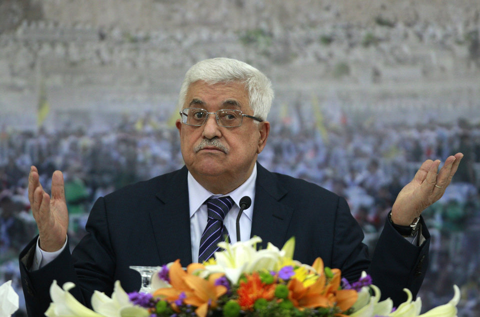 Photo -   Palestinian President Mahmoud Abbas speaks during a meeting of the Palestinian leadership at his compound in the West Bank city of Ramallah, Friday, Nov. 16, 2012. Abbas said in a televised speech Friday that he has urged the U.S. and European countries to pressure Israel to halt the offensive. Abbas said he also called Gaza Prime Minister Ismail Haniyeh of Hamas and the Islamists' top leader in exile, Khaled Mashaal, calling for Palestinian unity.(AP Photo/Majdi Mohammed)