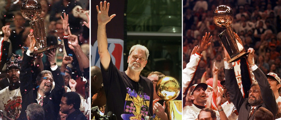 Photo - FILE - At left, in a  June 13, 1997, file photo, Chicago Bulls coach Phil Jackson hoists the NBA Championship trophy aloft after the Bulls beat the Utah Jazz 90-86 in Game 6 of the NBA Finals. in Chicago. At center, in a June 21, 2000 file photo, Los Angeles Lakers head coach Phil Jackson waves to the crowd as the Lakers and thousands of their fans celebrate their NBA Championship in downtown Los Angeles. At right, in a June 16, 1996 file photo, Chicago Bulls coach Phil Jackson hoists the NBA championship trophy after the Bulls beat Seattle in Game 6 of the NBA Finals in Chicago. Carmelo Anthony says he has heard that 11-time NBA champion coach Phil Jackson will be