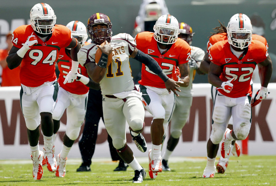 Photo -   Bethune-Cookman quarterback Brodrick Waters (11) scrambles with the ball against Miami in the first half of an NCAA college football game, Saturday Sept. 15, 2012, in Miami. (AP Photo/Wilfredo Lee)