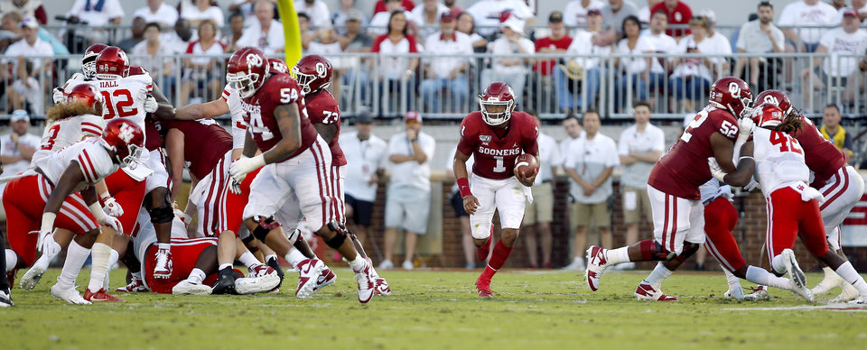 Photo - Oklahoma's Jalen Hurts (1) rushes in the first quarter during a college football game between the University of Oklahoma Sooners (OU) and the Houston Cougars at Gaylord Family-Oklahoma Memorial Stadium in Norman, Okla., Sunday, Sept. 1, 2019. [Sarah Phipps/The Oklahoman]