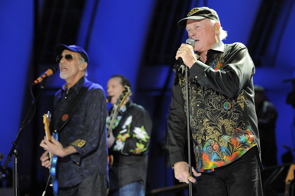Photo -   FILE - In this June 2, 2012 file photo, Mike Love, right, of The Beach Boys, performs alongside fellow band member David Marks at the Hollywood Bowl in Los Angeles. Brian Wilson says he felt blindsided by a news release from his Beach Boys bandmate Mike Love that ended the good vibrations on the band's 50th anniversary tour. Wilson says the expectation was that both sides would help craft and approve the news release. That didn't happen and now he thinks it's Love's turn to reach out. (Photo by Chris Pizzello/Invision/AP, File)