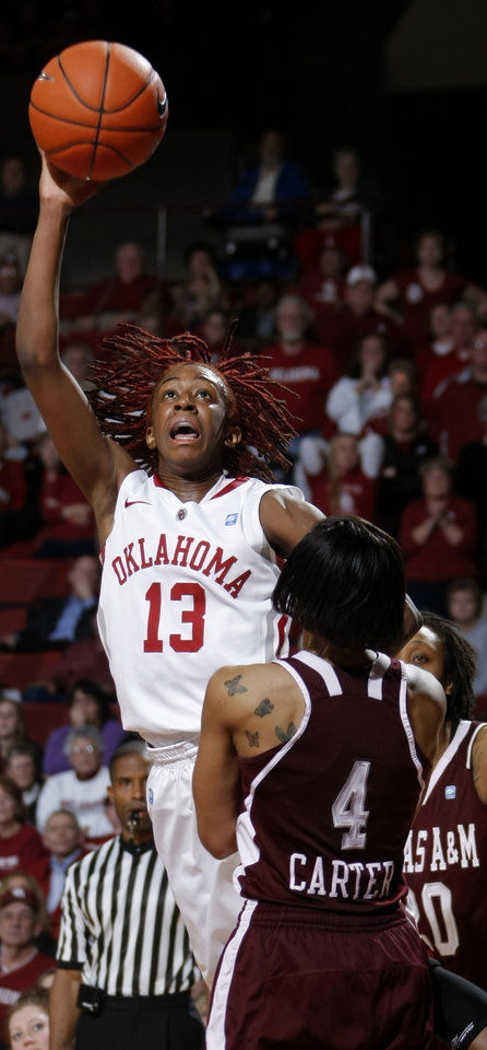Photo - OU's Danielle Robinson (13) shoots the ball in front of Texas A&M's Sydney Carter (4) during the Big 12 women's basketball game between the University of Oklahoma and Texas A&M at Lloyd Noble Center in Norman, Okla., Wednesday January 26, 2011.  Photo by Bryan Terry, The Oklahoman