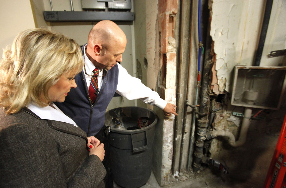 Gov. Mary Fallin and Doug Kellogg, with the Office of Management and Enterprise Services, tour deteriorating areas of state Capitol on Thursday. Photos By David McDaniel, The Oklahoman