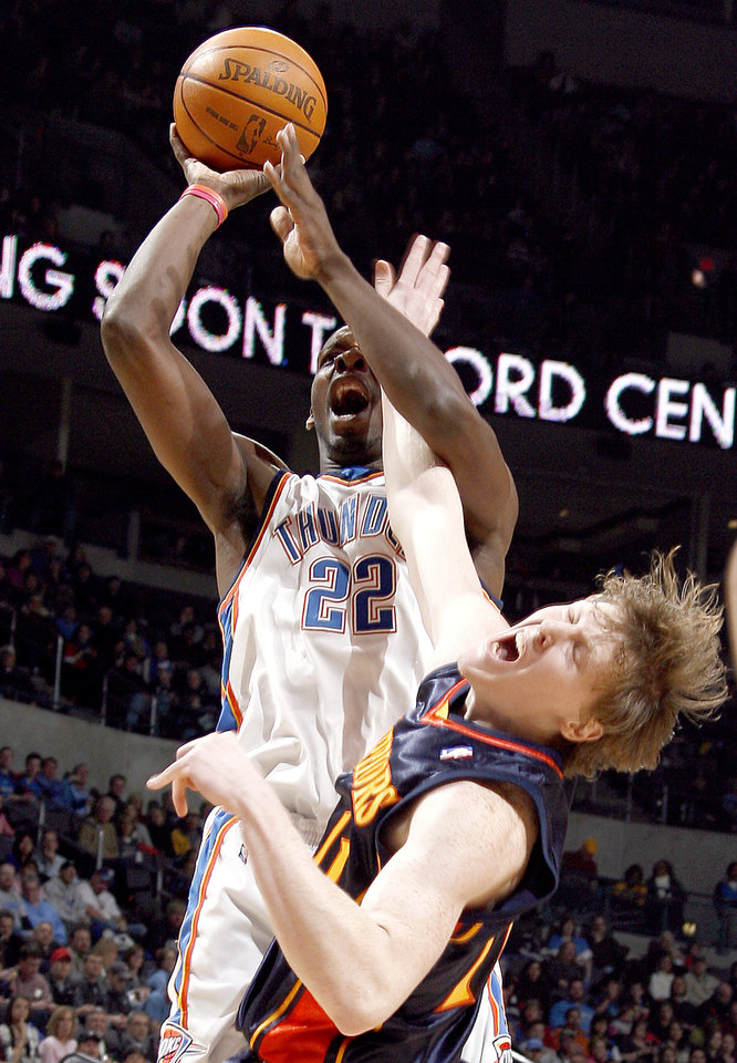 Photo - Oklahoma City's Jeff Green (22) shoots as Golden State's Coby Karl (11) defends during the NBA game between the Oklahoma City Thunder and Golden State Warriors, Sunday, Jan. 31, 2010, at the Ford Center in Oklahoma City. Photo by Sarah Phipps, The Oklahoman