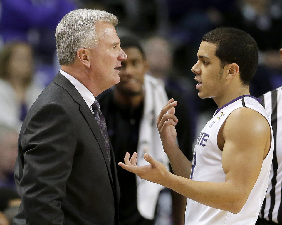 Kansas State guard Angel Rodriguez talks to coach Bruce Weber during the first half of an NCAA college basketball game against Texas Southern on Tuesday, Dec. 18, 2012, in Manhattan, Kan. (AP Photo/Charlie Riedel)