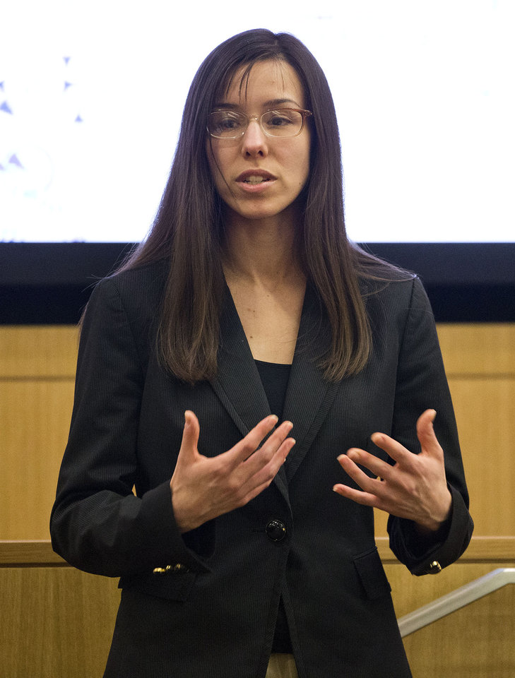 "FILE - This Feb. 28, 2013 file photo shows Jodi Arias preparing to demonstrate how she says Travis Alexander lunged at her ""like a linebacker,"" during her murder trial in Phoenix. Known as a bulldog with a one-speed, pedal-to-the-metal approach to prosecuting cases, Deputy Maricopa County Attorney Juan Martinez no doubt stumped Arias repeatedly throughout his intense cross-examination in her death penalty trial.   (AP Photo/The Arizona Republic, Tom Tingle, Pool, file)"
