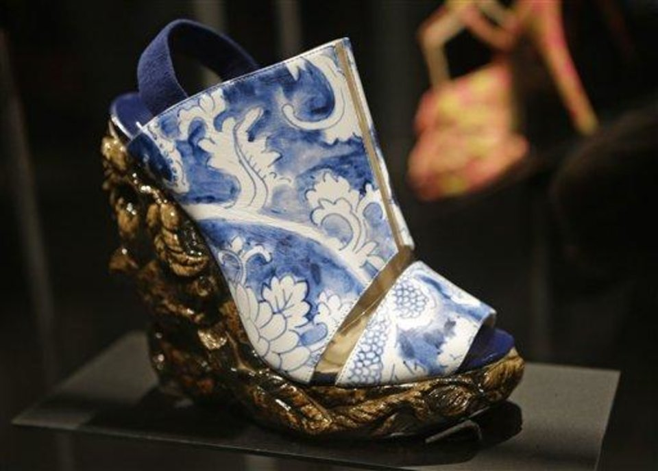 "This Feb. 11, 2013 photo shows a shoe designed by Nicholas Kirkwood for the Rodarte spring 2011 fashion show that has the appearance of antique ceramic ware is displayed at the ""Shoe Obsession"" exhibit at The Museum at the Fashion Institute of Technology Museum in New York. The exhibition, showing off 153 specimens, runs through April 13. (AP Photo/Kathy Willens)"