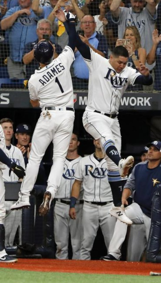 Photo -  Tampa Bay Rays' Willy Adames (1) celebrates his solo home run against the Houston Astros with right fielder Avisail Garcia in the fourth inning of Game 4 of the American League Division Series on Tuesday in St. Petersburg, Fla. The Rays won 4-1 to force Game 5. [AP Photo/Scott Audette]