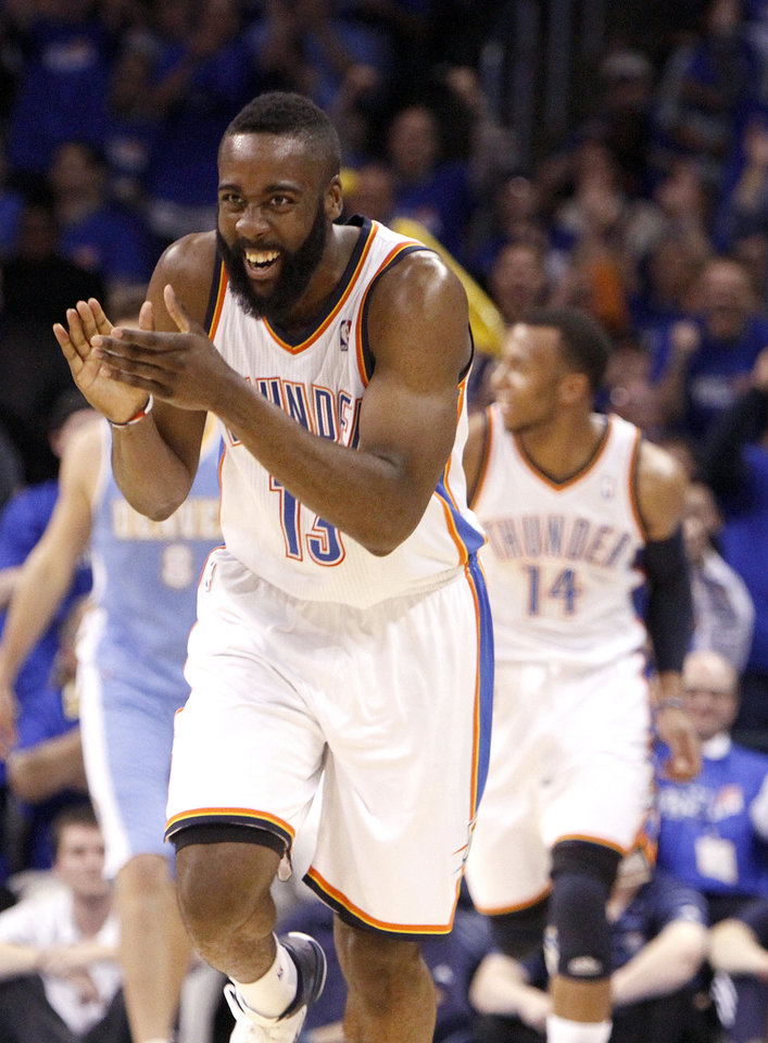 Photo - Oklahoma City's James Harden (13) celebrates during the first round NBA basketball playoff game between the Oklahoma City Thunder and the Denver Nuggets on Wednesday, April 20, 2011, at the Oklahoma City Arena. Photo by Sarah Phipps, The Oklahoman