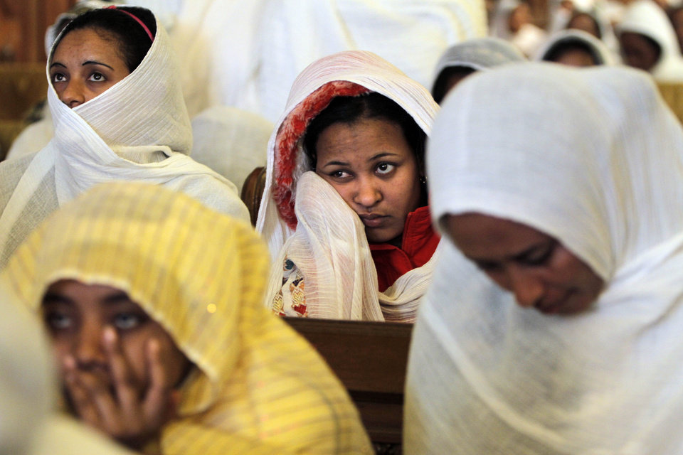Ethiopian Christians who live in Cairo, listen to a midnight Mass on the eve of Egyptian Orthodox Christmas at St. Mark\'s Cathedral in Cairo, Egypt, late Sunday, Jan. 6, 2013. (AP Photo/Amr Nabil) ORG XMIT: AMR105