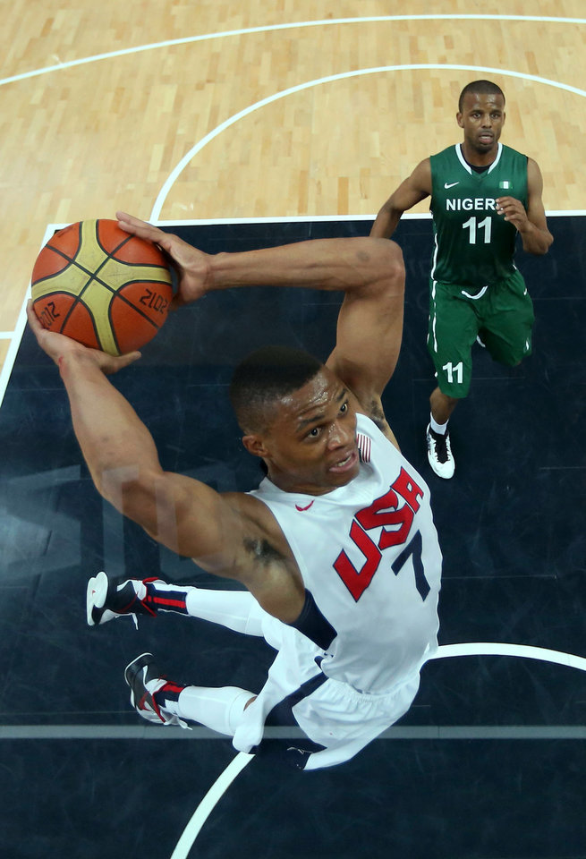 Photo -   Russell Westbrook (7) of the United States shoots against Richard Oruche (11) of Nigeria during their men's basketball preliminary round match at the 2012 Summer Olympics on Thursday, Aug. 2, 2012, in London. (AP Photo/Christian Petersen, Pool)