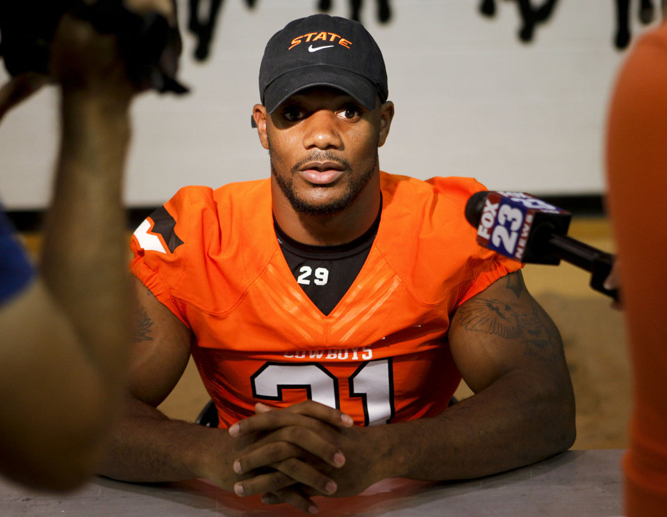 Photo - Jeremy Smith talks to reporters at the Oklahoma State football media day held at Gallagher-Iba Arena in Stillwater on August 3, 2013. KT King, For The Oklahoman