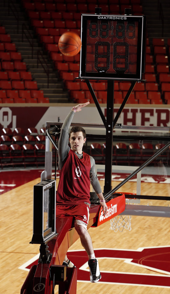 University of Oklahoma Sooner (OU) guard James Fraschilla practices a trick shot at The Lloyd Noble Center on Tuesday, Jan. 21, 2014  in Norman, Okla. Photo by Steve Sisney, The Oklahoman