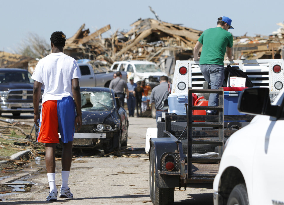 Oklahoma City Thunder's Hasheem Thabeet looks at damaged homes near SW 146th and Robinson in Oklahoma City, Wednesday May 22, 2013. Members of the Oklahoma City Thunder and family members took a tour of the area hit by a tornado on Monday afternoon. Photo By Steve Gooch, The Oklahoman